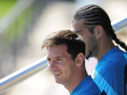 Messi com Pinto, no treinamento de hoje.