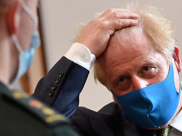 Britain's Prime Minister Boris Johnson talks with a paramedic as he visits headquarters of the London Ambulance Service NHS Trust, amid the spread of the coronavirus disease (COVID-19), in London, Britain July 13, 2020. Ben Stansall/Pool via REUTERS