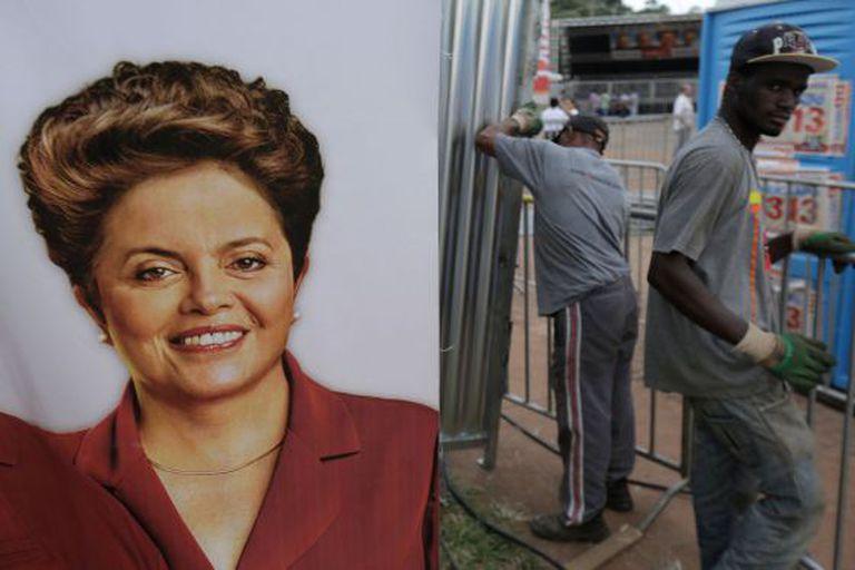 Cartaz de Dilma é pendurado em um ato de campanha.