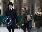 A man carries an EU themed wreath at Parliament Square, on Brexit day, in London, Britain January 31, 2020. REUTERS/Simon Dawson
