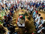 Indigenous people mourn Edwin Dagua during his funeral on December 9, 2018, in El Poblado, a rural village in the municipality of Caloto, Cauca department, Colombia. - Edwin Dagua, an indigenous leader on the Huellas reserve, was shot dead on December 7, 2018, after reporting that he had received death threats. (Photo by Luis ROBAYO / AFP)