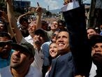 FILE PHOTO: Venezuelan opposition leader and self-proclaimed interim president Juan Guaido and opposition leader Henrique Capriles attend a rally against Venezuelan President Nicolas Maduro's government in Caracas, Venezuela February 2, 2019. REUTERS/Carlos Barria/File Photo/File Photo