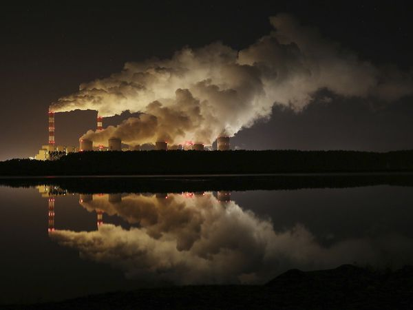 FILE in this Wednesday, Nov. 28, 2018 file photo Clouds of smoke over Europe's largest lignite power plant in Belchatow, central Poland. The U.N.?s climate chief Patricia Espinosa says deadlines set by some of the world's top polluters to end greenhouse gas emissions, along with president-elect Joe Biden's pledge to take the United States back into the Paris accord, have boosted hopes of meeting the pact's ambitious goals. (AP Photo/Czarek Sokolowski)