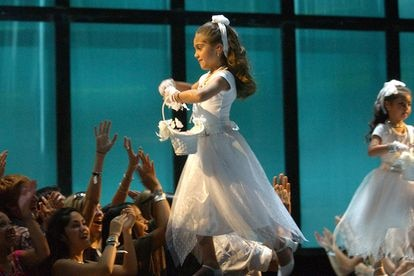 NEW YORK - AUGUST 28:  Lourdes Leon, daughter of Madonna dressed in a flower girl dress onstage during the 2003 MTV Video Music Awards at Radio City Music Hall on August 28, 2003 in New York City.  (Photo by Frank Micelotta/Getty Images)