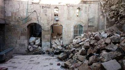 Edifício em ruínas em Aleppo Oriental.