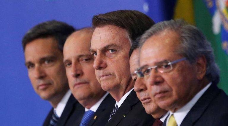 Jair Bolsonaro, Hamilton Mourão e Paulo Guedes em evento nesta quarta-feira.