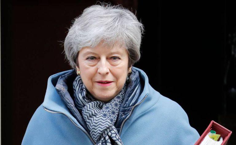 A primeira-ministra britânica Theresa May sai da sua residência oficial na última quarta-feira, 3