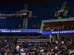 """(FILES) In this file photo the upper section of the arena is seen partially empty as US President Donald Trump speaks during a campaign rally at the BOK Center on June 20, 2020 in Tulsa, Oklahoma. - Legions of K-pop fans and TikTok users are taking credit for upending Donald Trump's weekend rally after block-reserving tickets with no intention to attend an event that was beset by an embarrassingly low turnout. (Photo by Nicholas Kamm / AFP) / TO GO WITH AFP STORY by Maggy DONALDSON: """"Online disruption of Trump rally highlights K-pop's political hustle"""""""