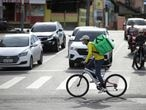 A mobile delivery app worker rides his bicycle amid the coronavirus disease (COVID-19) outbreak, in Manaus, Brazil March 27, 2020. REUTERS/Bruno Kelly