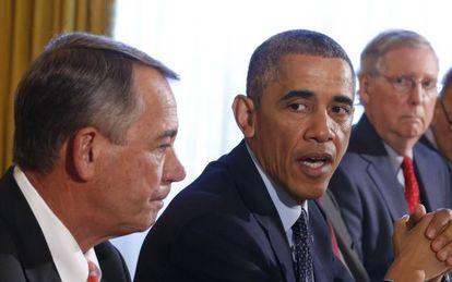 Obama entre os dois futuros líderes do Congresso.