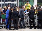 Brazilian President Jair Bolsonaro talks to supporters outside Planalto presidential palace in Brasilia, Brazil, Monday, Sept. 6, 2021. (AP Photo/Eraldo Peres)