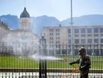 A soldier disinfects the surroundings of Narino presidential palace, as a preventive measure against the spread of the COVID-19 coronavirus in Bogota, on April 16, 2020. (Photo by Raul ARBOLEDA / AFP)