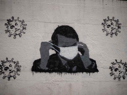 Grafite com o rosto de Bolsonaro em muro do Rio de Janeiro, em 12 de julho.