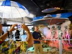 People take pictures of exhibits at the International UFO Museum and Research Center during the UFO Festival on July 2, 2021 in Roswell, New Mexico. - The festival returns during the July 4th holiday weekend following the Covid-19 pandemic. A highly awaited US intelligence report on dozens of mysterious unidentified flying object sightings said most could not be explained, but did not rule out that some could be alien spacecraft. The report made no mention of the possibility of -or rule out - that some of the objects sighted could represent extra-terrestrial life. The military and intelligence community have conducted research on them as a potential threat. (Photo by Patrick T. FALLON / AFP)