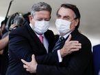 Brazil's President Jair Bolsonaro greets Brazil's Lower House Arthur Lira, after a meeting at the Planalto Palace, in Brasilia, Brazil, March 25, 2021. REUTERS/Ueslei Marcelino