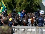 Brazil's President Jair Bolsonaro rides a horse during a meeting with supporters protesting in his favor, amid the coronavirus disease (COVID-19) outbreak, in Brasilia, Brazil May 31, 2020. REUTERS/Ueslei Marcelino     TPX IMAGES OF THE DAY
