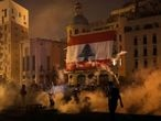 Tear gas is fired by police towards demonstrators during a protest following Tuesday's blast, in Beirut, Lebanon August 8, 2020. REUTERS/Thaier Al-Sudani