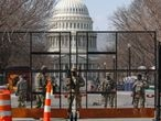 National Guard soldiers stand guard behind a security fence near the U.S. Capitol after police warned that a militia group might try to attack the Capitol complex in Washington, U.S. March 4, 2021. REUTERS/Jim Urquhart
