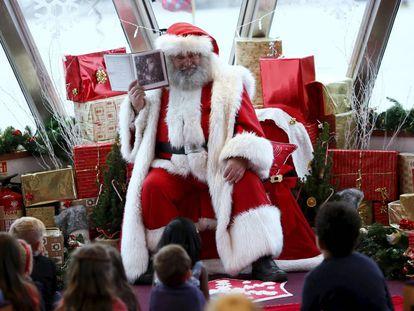 Por que você não deve ameaçar seu filho dizendo que o Papai Noel não vai trazer presentes