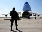 19 April 2020, France, Bussy-Lettrée: A French gendarme guards the Ukrainian Antonov An-225 Mriya cargo plane as it deliver sanitary equipment coming from China, at the Paris-Vatry airport in Bussy Lettree. The Ukrainian cargo plane Antonov-225 has arrived from  China with 8,6 million face masks and 150 tons of sanitary equipment ordered by a private customer amid the fight against Coronavirus (Covid-19). Photo: Francois Nascimbeni/AFP/dpa   19/04/2020 ONLY FOR USE IN SPAIN