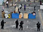 TOPSHOT - Demonstrators clash with riot police during a protest against a proposed government tax reform in Cali, Colombia, on May 3, 2021. - Protesters in Colombia on May 3 called for a new mass rally after 19 people died and more than 800 were wounded in clashes during five days of demonstrations against a proposed government tax reform. Faced with the unrest, the government of President Ivan Duque on May 2 ordered the tax reform proposal be withdrawn from Congress, where it was being debated. (Photo by Luis ROBAYO / AFP)