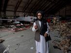 Central Asia - Afghanistan, capital city Kabul: A Taliban at airport hangar where destroyed airplanes and the military equipment were left at Hamid Karzai International Airport on the morning after the United States armed forces had officially left the country and ended its longest war, the US military destroyed all the military equipment left behind after their retreat. Afghanistan is now under  complete power of the Taliban.