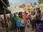 A woman carries a box with food donations organized by NGO Kapadocia Institute for poor families from Capadocia Slum at Brasilandia district amid the coronavirus disease (COVID-19) outbreak, in Sao Paulo, Brazil, May 1, 2020.REUTERS/Amanda Perobelli