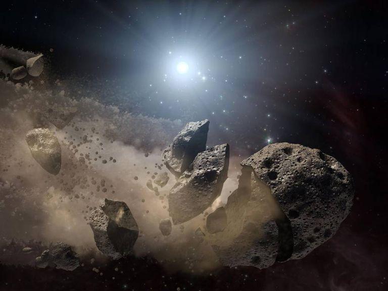 Recriação artística de um asteroide se rompendo.