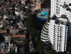 An aerial view shows the city's biggest slum Paraisopolis next to luxury apartment buildings, after residents have hired a round-the-clock private medical service to fight the coronavirus disease (COVID-19), in Sao Paulo, Brazil April 2, 2020. REUTERS/Amanda Perobelli