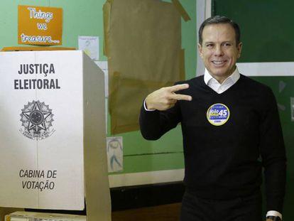 Resultado eleiçoes 2016 O candidato do PSDB, João Doria, vota em São Paulo. NELSON ANTOINE AP
