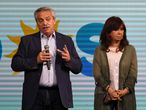 """Picture released by Telam showing Argentina's President Alberto Fernandez (L) and vice President Cristina Fernandez de Kirchner addressing the media following the results of the primary legislative elections, at the Frente de Todos party headquarters in Buenos Aires on September 13, 2021. - Argentine legislative primaries dealt a strong blow to the government of center-left Peronist Alberto Fernandez, as the candidates of the opposition center-right alliance Juntos were the most voted ahead of the mid-term elections next November 14. (Photo by Maximiliano LUNA / TELAM / AFP) / Argentina OUT / ARGENTINA OUT - RESTRICTED TO EDITORIAL USE - MANDATORY CREDIT """"AFP PHOTO/ TELAM - MAXIMILIANO LUNA"""" - NO MARKETING NO ADVERTISING CAMPAIGNS - DISTRIBUTED AS A SERVICE TO CLIENTS"""