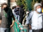 People wait in line outside San Giovanni hospital to get tested for COVID-19, in Rome on Oct. 8, 2020. Europe's second wave of coronavirus infections has struck well before flu season even started. People waited in line for 8-10 hours to get tested, while front-line medics from Kiev to Paris found themselves once again pulling long, short-staffed shifts in overcrowded wards. (AP Photo/Gregorio Borgia)