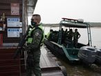 Police and health agents, notify a floating house, located on the Negro River in Manaus, which operates illegally during the operation to comply with the state decree that closes bars, nightclubs and beaches, due to the increase in new cases of contamination by the Corona Virus in Manaus, Amazonas, Brazil. Bruno Kelly / El Pais.
