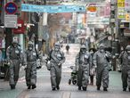 "SEOUL, SOUTH KOREA - MARCH 04: South Korean soldiers, in protective gear, disinfect the Eunpyeong district against the coronavirus (COVID-19) on March 04, 2020 in Seoul, South Korea. The South Korean government has raised the coronavirus alert to the ""highest level"" as confirmed case numbers continue to rise across the country. According to the Korea Centers for Disease Control and Prevention, 516 new cases were reported on Wednesday, with the death toll rising to 33. The total number of infections in the nation stands at 5,328, the highest outside of China. (Photo by Woohae Cho/Getty Images)"