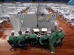 Nurses work during New Year's Eve at a field hospital set up at a sports gym to treat patients suffering with the coronavirus disease (COVID-19) in Santo Andre, Sao Paulo state, Brazil, December 31, 2020. REUTERS/Amanda Perobelli     TPX IMAGES OF THE DAY