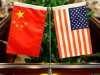 (FILES) In this file photo taken on June 30, 2017, flags of the US and China are placed ahead of a meeting at the Ministry of Agriculture in Beijing. - The United States has ordered China to close its Houston consulate, Beijing said on July 22, 2020, marking a dramatic escalation in diplomatic tensions between the feuding superpowers (Photo by JASON LEE / POOL / AFP)