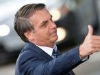 Brazil's President Jair Bolsonaro gestures as he leaves the Alvorada Palace in Brasilia, Brazil January 22, 2020. REUTERS/Adriano Machado