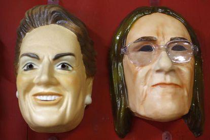 Máscaras dos rostos de Dilma e Graça Foster.