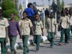 A group of schoolboys are escorted by Nigerian military and officials following their release after they were kidnapped last week, Friday Dec. 18, 2020 in Katsina, Nigeria. More than 300 schoolboys kidnapped last week in an attack on their school in northwest Nigeria have arrived in the capital of Katsina state to celebrate their release. The boys were abducted one week ago from the all-boys Government Science Secondary School in Kankara in Katsina state village.  Nigeria's Boko Haram jihadist rebels claimed responsibility for the abduction. saying they attacked the school because it believes Western education is un-Islamic, factional leader Abubakar Shekau said in a video earlier this week. (AP Photo/Sunday Alamba)