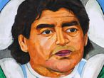 26 November 2020, India, Mumbai: An artist puts the final touches on paints of the late football legend Diego Maradona. Photo: Ashish Vaishnav/SOPA Images via ZUMA Wire/dpa