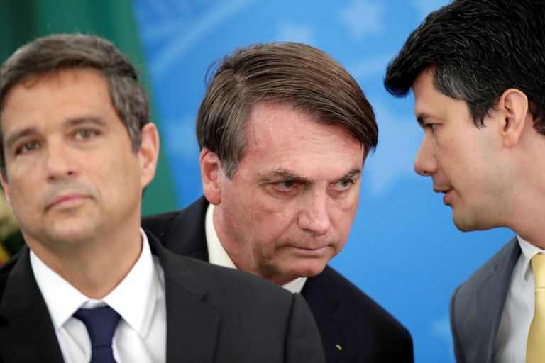 Presidente do Banco Central, Roberto Campos Netos, Jair Bolsonaro, e o presidente do BNDES, Gustavo Montezano durante o anúncio em Brasília.
