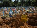 FILE PHOTO: A gravedigger works at the Parque Taruma cemetery amid the coronavirus outbreak in Manaus, Brazil, December 31, 2020. REUTERS/Bruno Kelly/File Photo