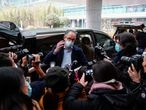 Peter Ben Embarek, a member of the World Health Organisation (WHO) team tasked with investigating the origins of the coronavirus disease (COVID-19), gestures in front of media as he arrives at the airport, in Wuhan, Hubei province, China February 10, 2021. REUTERS/Aly Song