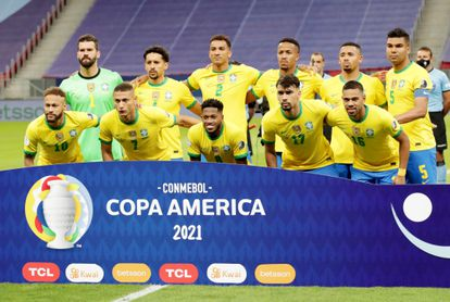 Brazil players pose for a team group photo before the match REUTERS/Henry Romero