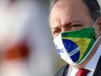 FILE PHOTO: Brazil's interim Health Minister Eduardo Pazuello wears a protective face mask as he looks on before a national flag hoisting ceremony in front the Alvorada Palace, amid the coronavirus disease (COVID-19) outbreak, in Brasilia, Brazil June 9, 2020. REUTERS/Adriano Machado/File Photo