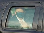 US President Trump waves from the back of a car in a motorcade outside of Walter Reed Medical Center in Bethesda, Maryland on Ocotber 4, 2020. (Photo by ALEX EDELMAN / AFP)
