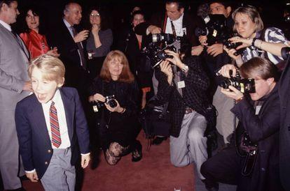 Macaulay Culkin, com10 anos, em um evento realizado em 1990, ano em que filmou 'Esqueceram de Mim'. O filme se tornou a terceira maior bilheteria até aquele momento (depois de E. T. e Guerra nas Estrelas).