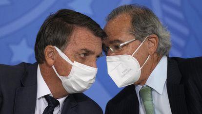 Bolsonaro e Paulo Guedes em cerimônia em Brasília, no último dia 11 de agosto