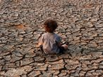TO GO WITH AFP PACKAGE : Fifth anniversary of Paris Agreement on climate change - (FILES) In this file photo taken on April 22, 2016 a child remains at an area affected by a drought on Earth Day in the southern outskirts of Tegucigalpa on April 22, 2016. (Photo by ORLANDO SIERRA / AFP)