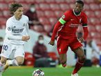 Soccer Football - Champions League - Quarter Final Second Leg - Liverpool v Real Madrid - Anfield, Liverpool, Britain - April 14, 2021 Real Madrid's Luka Modric in action with Liverpool's Georginio Wijnaldum REUTERS/David Klein